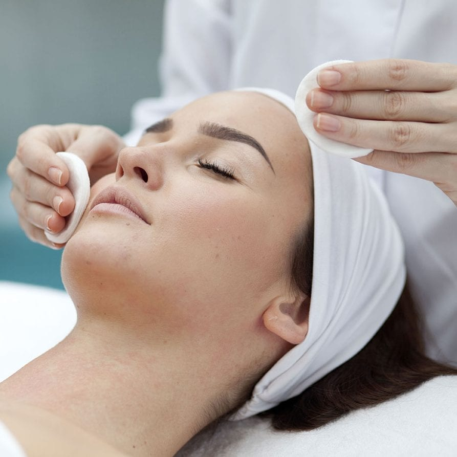 Image of woman having facial treatment for chemical peels and collagen induction therapy blog post