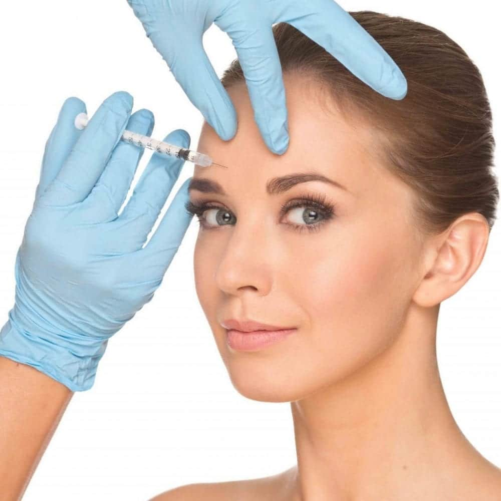Image of woman having botox injection to forehead wrinkles for regulation and safety in aesthetic treatments blog post