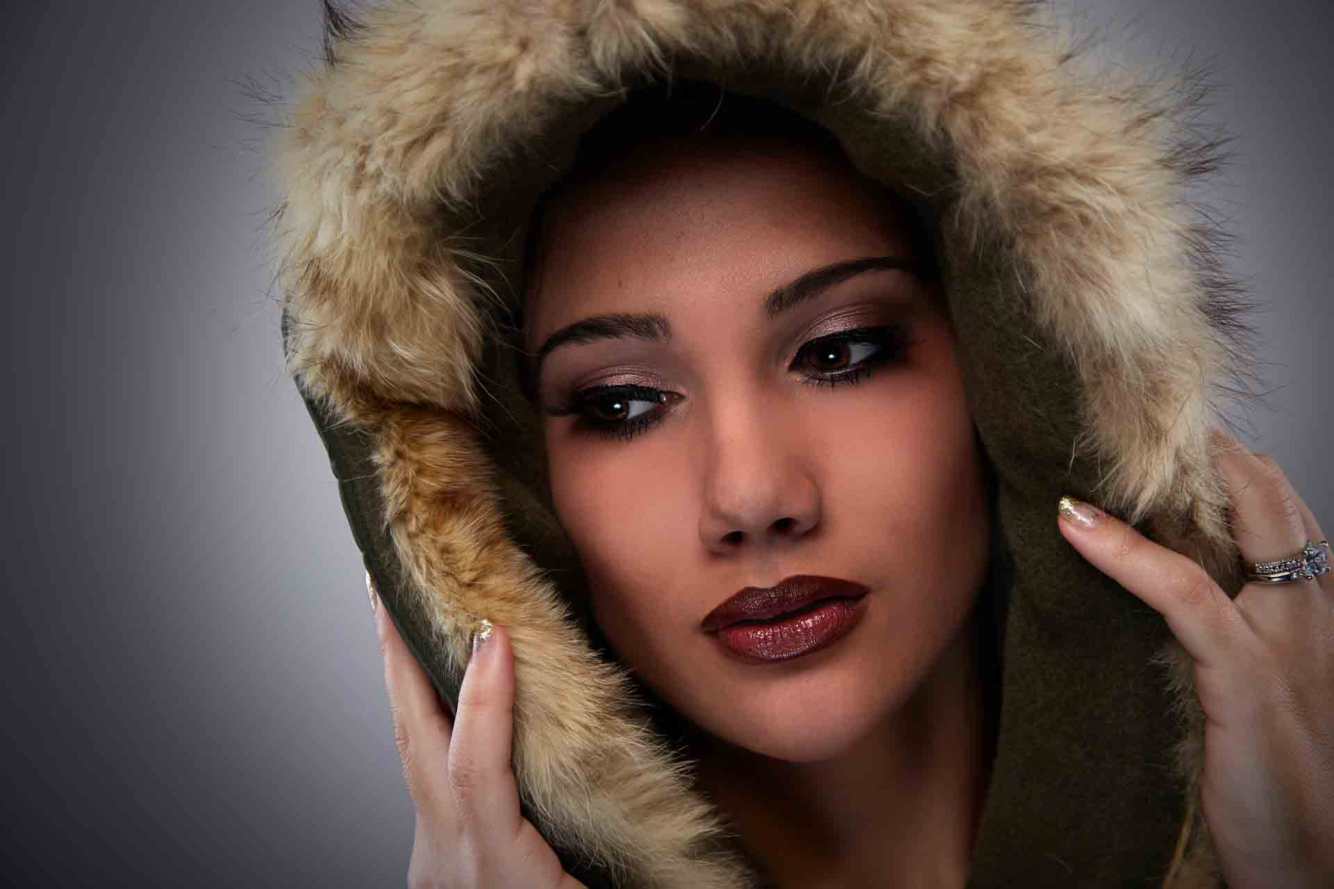 Image of woman wearing a hood with defined jaw for jaw enhancement with jaw fillers blog post