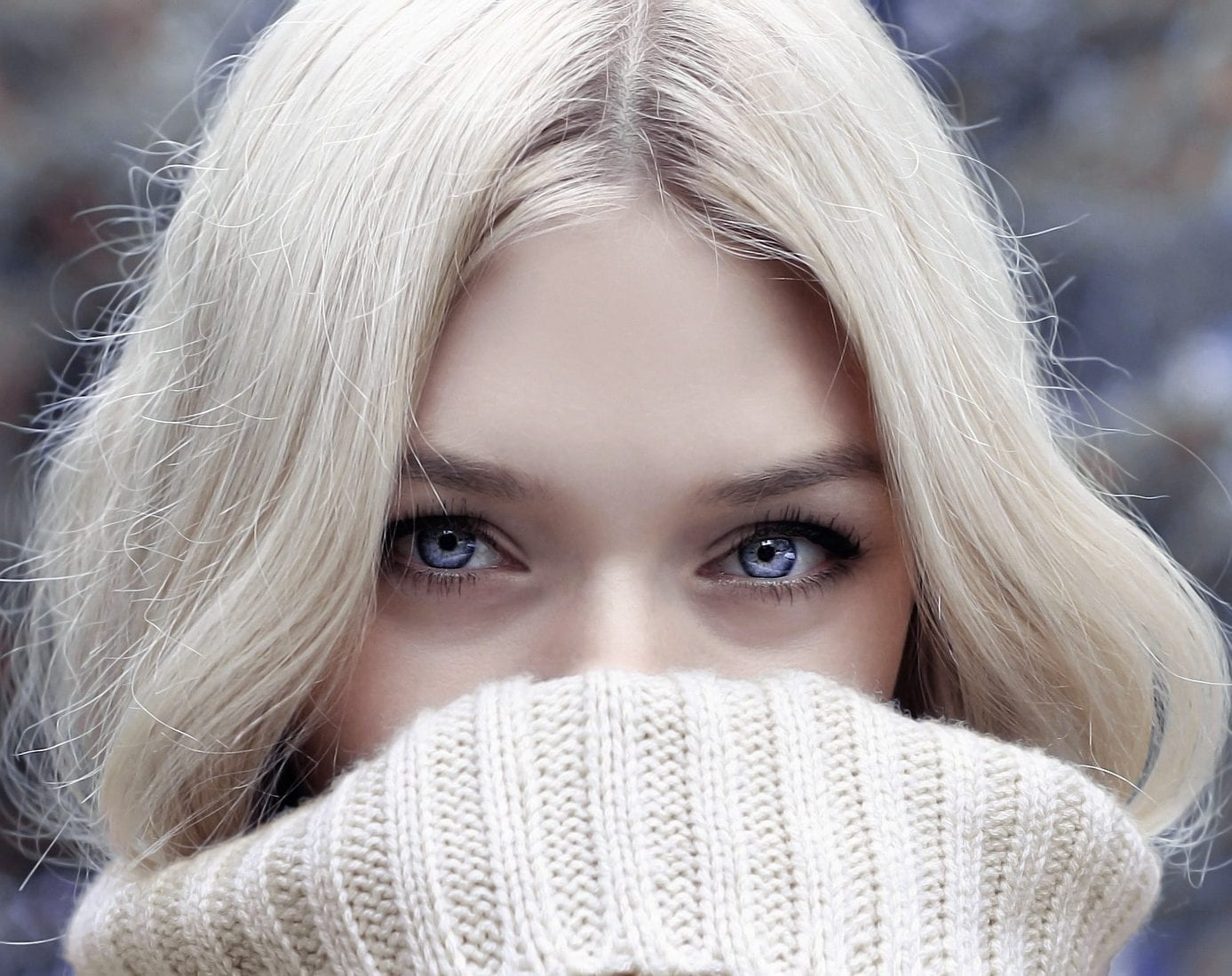 Image of woman wearing thick jumper for winter skin and winter skincare blog post