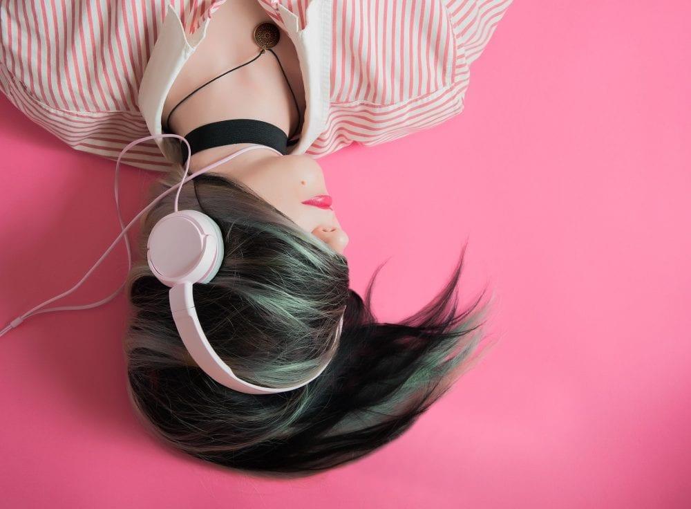 Image of woman listening to music with headphones for sunday vibes beauty digest on The blog from City Skin Clinic