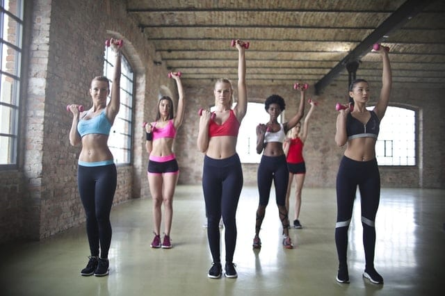Image of women in exercise class working out for post on 5 Top Tips for clear and healthy skin whilst staying active