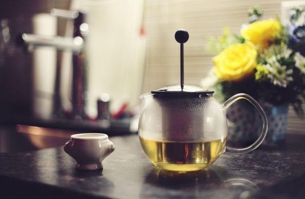 Image of tea pot for green tea under eye mask